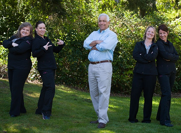 Dr. Schur and his staff being silly outside their Redmond area orthodontic practice.