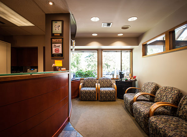 The front desk and waiting area of Schur Orthodontics.