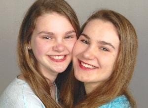 Two sisters who are actual patients of Schur Orthodontics in Bellevue.